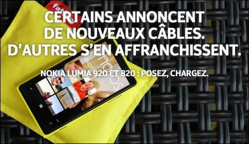 publicite comparative moquerie Nokia Lumia vs Apple iPhone 5 recharge sans fil